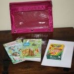 Mini coloring/sticker books, paper, and crayons