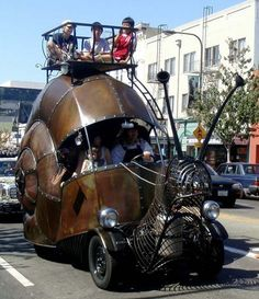 """This awesome snail art car was photographed in 2008 by aparna at the """"How Berkeley Can You Be?"""" Parade & Festival in Berkeley, California.  [via AutoDen]~♛"""