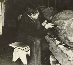 Tlingit man named Andy Mather carving a totem pole, Wrangell, Alaska, 1939. :: American Indians of the Pacific Northwest -- Image Portion