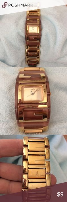 "Beautiful "" Guess watch "" Got this as a gift some years ago but its to big for me, its made by "" Guess "", its a copper color lucite around the bezel, and gold tone chunky links around wrist, face still had the scratch protector on it, it dies need a new battery , I have never replaced it since I have had it and its been kept in my jewelry box , it is a very lovely watch . Guess Jewelry"