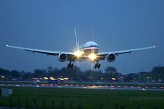 Night Flight - American Airlines Boeing 777 200 late evening arrival at London Heathrow Airport UK