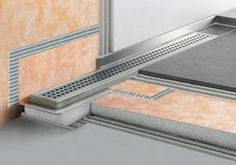 Schluter-KERDI-LINE - Linear Floor Drain allows for large format tiles.