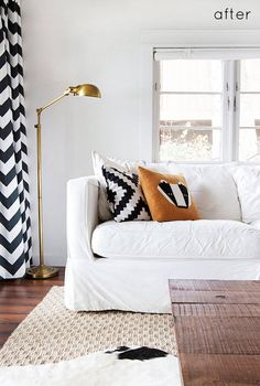Living Room: Sisal/Plain Rug with Chevron Curtains.    graphic black + white with brass accents. I ADORE the simplicity w/graphics!