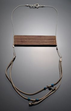 Leslie Shershow  Necklace: Mooring 2012  Walnut, silver, brass, vintage fishing line