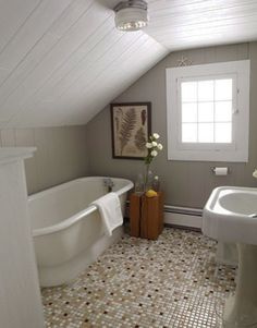 would prefer a black and white octagonal tile floor, more vintage. Love the use of an awkward room and that window and tub!