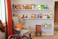 The Ikea Ribba picture ledges look great as bookshelves! and as picure organisers. buying about ten of them!