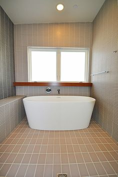 modern bath taupe tile and wood