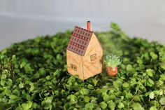 Handmade tiny houses, toy houses, folklore houses, wood and paper houses, miniature art houses, tiny village, mini house, small world house, house sculpture, house figurine, housewarming gift, wedding gift, couple gift, new home gifts, new house gift gardener's gift, art paper houses, postage stamp houses, collectible houses, shelf art, 100% of profits donated to charity.