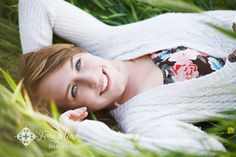 Gorgeous senior pose in tall green grass
