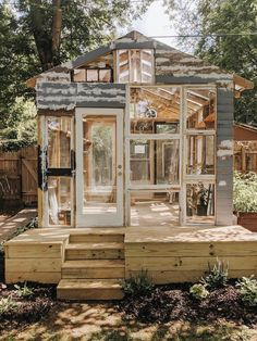 Greenhouse built from recycled windows Diy Greenhouse Plans, Backyard Greenhouse, Backyard Landscaping, Old Window Greenhouse, Greenhouse Kits For Sale, Recycled Windows, Reclaimed Windows, Glass House, Dream Garden