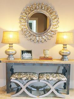 Benches under console table behind couch for extra guest seating
