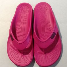 Hot Pink Crocs Flip Flops Size 9 I love the free feeling of crocs!  Save for summer, take on vacation, or just wear around the house.  The quality of Crocs make these a great pre-loved shoe that continues to hold up.  Easy to clean.  Comfortable band across the top of the foot.  You will love them! crocs Shoes Sandals