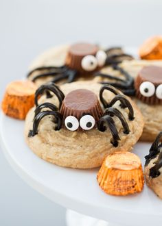 Adorable spider cookies made with a REESE'S Peanut Butter Cups Miniatures, candy eyes and TWIZZLERS Twists. These are the perfect Halloween cookie for a Halloween party! Made with @HERSHEY'S #ad