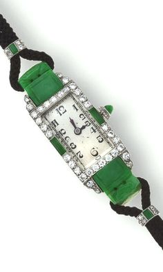 An art deco diamond and jadeite jade wristwatch, Marsh  Co, circa 1930 the rectangular silvered dial with black Arabic numerals and blued steel hands within a bezel of circular-cut diamonds accentuated with jadeite panels and winder, completed by a black silk cord bracelet with jadeite and diamond detail; unsigned, attributed to Marsh; mounted in platinum; length: 6 5/8in.