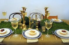 Moss, brass, and blue willow. Rentals and styling by Chicago Vintage Weddings, photography by Carisa Mitchell