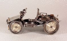 Old Watch Parts Become Intricate, Miniature Motorcycles & Cars