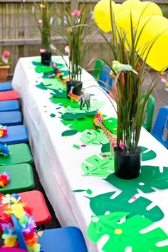 Palm frawn adorned party table from Tropical Rainforest Jungle Animal Birthday Party at Kara's Party Ideas. See all the pictures at karaspartyideas.com!