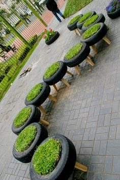 recycled tyres used as planters in Invasion Verde, a public park in Lima, Peru