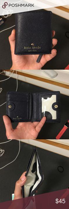 Kate spade cedar street fold wallet navy blue Kate Spade wallet, in navy blue is in good condition! Zip pocket for coins, open up for cash, and I believe 6 slots for cards and 1 window slot for your identification card kate spade Bags Wallets