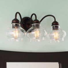Clear Cloche Glass Bath Light- 3 Light - Also going up in the hallway bathroom.  Very excited!