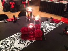 http://simplyunique-kc.com/wedding - Gorgeous red and black centerpieces. Elegant and sophisticated. Simply Unique Events.