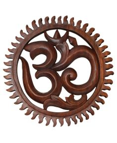 Om wall hanging carved from suar wood, made by skilled artists in Indonesia. Om art available at BuddhaGroove.com.
