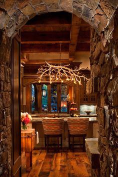 Wonderful Stone arch leading to the Kitchen.