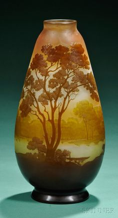 Galle Decorated Cameo Glass Vase  Art glass  France, early 20th century  Cameo acid-etched tree and waterscape in shades of brown and green on gold to green color gradient background, marked Galle in the making.