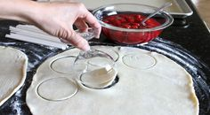 using a glass rim to cut out circles of dough