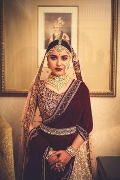 Stunning Marsala lehenga with a unique drape and beautiful makeup! | Wedmegood .... #Wedmegood #bridallehenga #marsalalehenga #dupattadrape #marsala #indianwedding