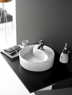 Lavabo Yin Yang circular, de porcelana sobre encimera, sin rebosadero y sin opción de ir en pared. Referencia: 0040B Medidas: 400x120 mm
