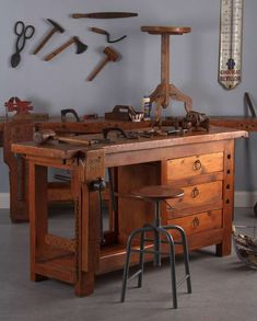 French Carpenter's Workbench in Elm, is part of Workbench - For Sale on A rustic vintage carpenter's workbench in elmwood complete with drawers and clamps, French, 1950 Beautifully worn elmwood carries the marks from decades