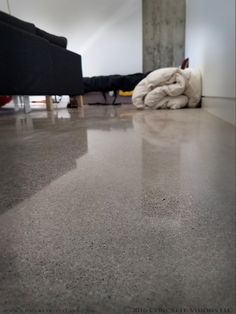The salt and pepper exposed aggregate in these 800-grit, semi-polished concrete floors provides a great neutral color that won't overwhelm your home's design! Call us today to upgrade your floors to beautiful, long-lasting, environmentally friendly polished concrete! #800grit #polishedconcrete #interiordesign #homeremodel #Boulder