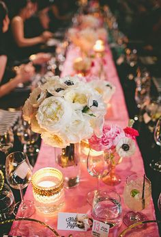 black tablecloth, pink runner, white flowers and gold trimmed glass votive candle holders create glam in a simple way