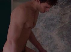 Christian getting into the bath.    So hot