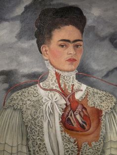 This is one of Frida Kahlo's self portraits by the name of Las Dos Fridas. This painting is one of two. Each piece exposes one of Frida's personalities. Painted in 1939