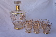 Beautiful French Vintage 1930's gold trim decanter and 6 glass set. French Vintage chic.