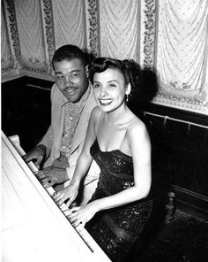 Boxer Joe Louis sits beside singer Lena Horne at a piano in a nightclub in Chicago, ILL., on June 5, 1949. (AP Photo)