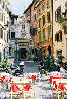 Street tables, Rome. I love how they have these tables in the middle of the old cobblestone streets in Rome!