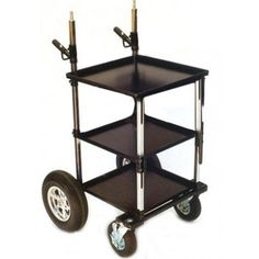 "Backstage Video Transformer Cart - Product Features Middle Shelf, Stand Holders, Handles and Rack Mounts can be adjusted to the desired height. 5/8"" pins accommodates monitor trays. Transformer System, fully collapsible. 19"" rack mounts. Adjustable middle shelf. Handles with cable hooks (2) and Electric stand holders (2). The two rear wheels are 16"" pneumatic and the two front 8"" pneumatic wheels have swivel casters with brakes."