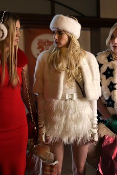 Chanel Oberlin wearing Lilly e Violetta Sarah Mink-fur Cropped Jacket, Express Ostrich Feather Fringe Mini Skirt
