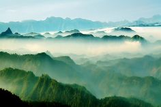 The blue range of mountains that run along the western coast of India.  This shot taken in mid May from Palivasal Tea Estate in Munnar in Kerala on a morning when the clouds are still sitting in the valley and the sun is illuminating them as they slowly rise up with the passage of the day.