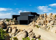 """This all-black house in the Yucca Valley desert was designed by Los Angeles office Oller & Pejic to look """"like a shadow""""."""