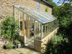 Cheap DIY Greenhouse Plans- Large or small, building a greenhouse doesn't have to break the bank. Here are inexpensive DIY greenhouse ideas that include plans or . *** More details can be found by clicking on the image. Lean To Greenhouse, Indoor Greenhouse, Greenhouse Growing, Greenhouse Wedding, Greenhouse Plans, Underground Greenhouse, Cheap Greenhouse, Indoor Garden, Pallet Greenhouse