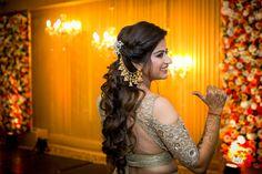 Indian hairstyles for weddings with Bahubali jhumkas - mehendi hairstyles