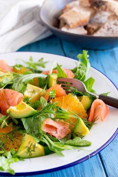 Smoked Salmon, Sweet orange, peppery leaves, fresh herbs and creamy avocado. This smoked salmon, orange and avocado salad is packed with flavours and textures. So delicious and so beautiful it is sure to become a firm favourite. Smoked Salmon Salad, Salmon Salad Recipes, Fresh Salad Recipes, Salmon Avocado, Avocado Recipes, Healthy Salad Recipes, Avocado Salads, Kale Salads, Salad Presentation
