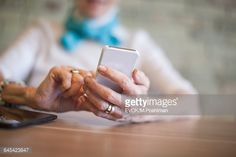 Stock Photo : Senior woman hands texting