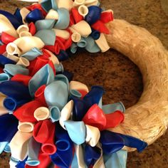 Balloon wreath for circus theme birthday party.  How creative!