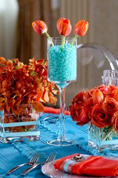 Orange Tulips & Roses Set Amongst Turquoise- Love the jelly beans with the tulips Decoration Table, Table Centerpieces, Turquoise Centerpieces, Centrepieces, Centerpiece Ideas, Orange And Turquoise, Aqua, Beautiful Table Settings, Orange Wedding