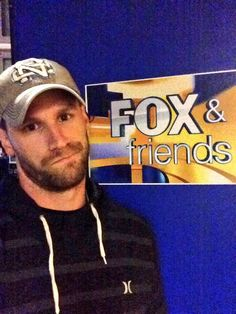 Chase Rice with a cute smirk / Country western singer.